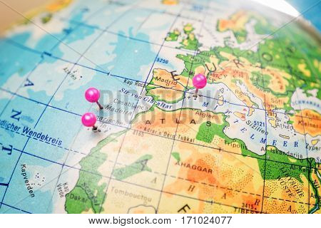 Travel location Islands of Madeira, Tenerife and Mallorca. Pink pins on the world globe