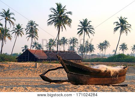 fishing boat on the sandy shore in Goa
