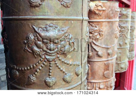 Buddhist prayer wheels in the chinese monastery