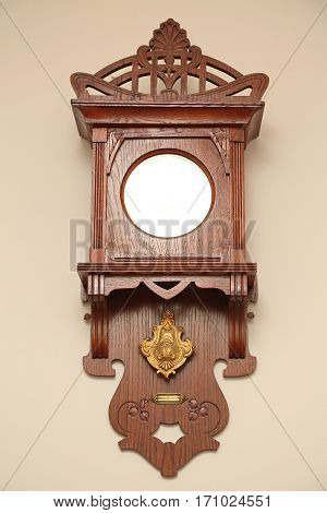 Antique Wooden Clock With Pendulum at Wall