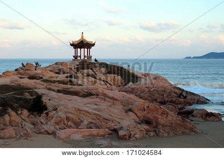 Chinese pavilion on the beach of East Chinese sea