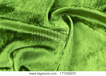 green silk velvet close-up. Fabric macro for texture and background