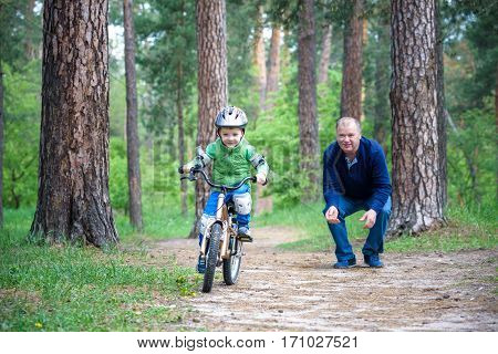 Happy Cute Blond Kid Boy Having Fun His First Bike On Sunny Summ