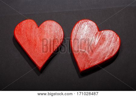 Holidays gift and heart on a black background. Valentines day