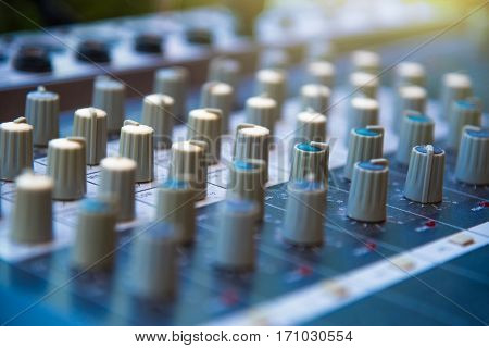 Audio sound mixer khob button board panel&amplifier equipment sound mixing&engineering concept selective focus