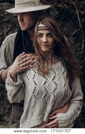 Stylish Hipster Couple Hugging. Boho Gypsy Woman And Man In Hat Embracing Holding Hands In Windy Woo