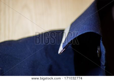blue shirt collar with button macro shot