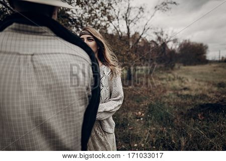Stylish Hipster Man In Cowboy Shirt And Hat Looking At Emotional Gypsy Hipster Woman, Autumn Field B