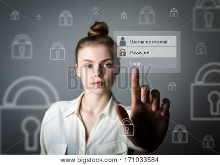 Young slim womanl in white is pushing the virtual button. Login and password concept.