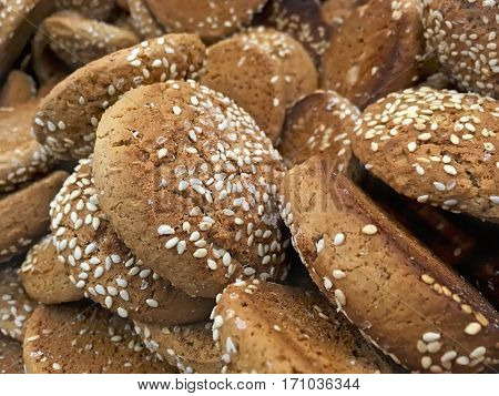 Food background - Delicious oatmeal cookies with sesame seeds closeup
