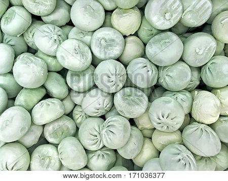 Food background - Green raw ravioli in Georgian (khinkali) close-up