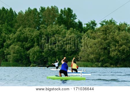 group young rowers canoeists paddling on lake rowing competitions