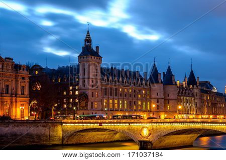 Conciergerie by winter night view, beautiful Paris