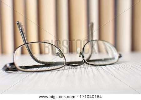Reading Glasses In Front Of Books