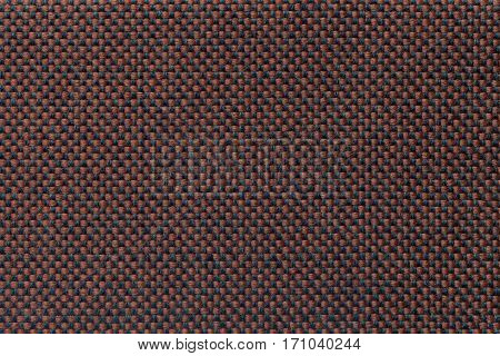 Brown and black background with checkered pattern closeup. Structure of the fabric with checkerboard pattern macro.