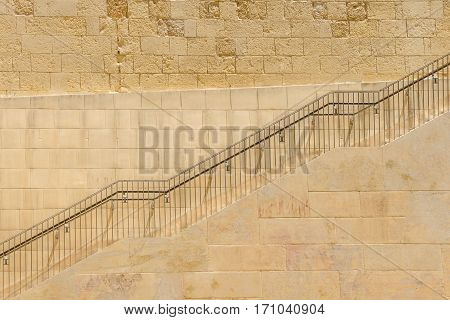 The climb stone ladders with metal handrail