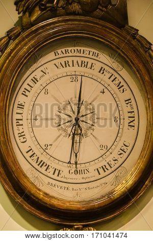 Vintage antique old barometer on the wall