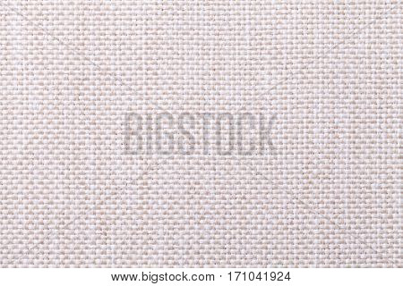 White and beige background with checkered pattern closeup. Structure of the fabric with checkerboard pattern macro.