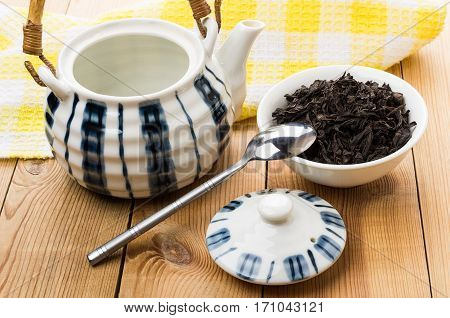 Opened Porcelain Teapot, Bowl With Dry Black Tea And Teaspoon
