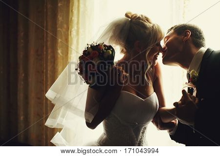 Just Married Kiss Illuminated By Daylights In A Restaurant Hall