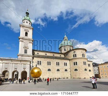 SALZBURG/ AUSTRIA - FEBRUARY 24. Salzburg Cathedral and Monument to the confectioner Paul Fuerst (creator of the famous candy Mozartkugel) on February 24, 2016. Salzburg, Austria.