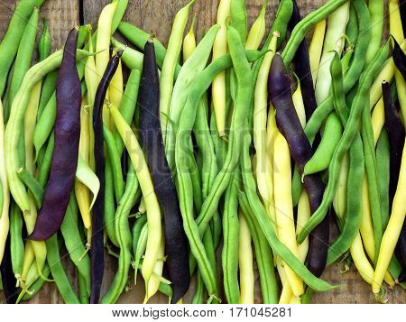 Fresh Green, Yellow And Purple Green Beans, Asparagus On A Wooden Background