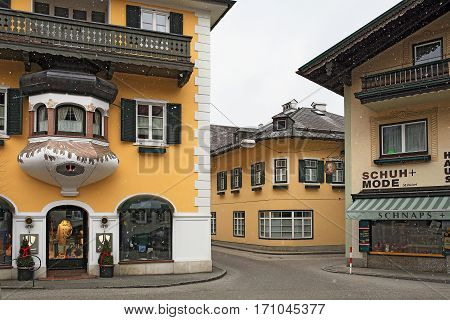 SANKT GILGEN/ AUSTRIA - FEBRUARY 25, 2016: Small picturesque alpine village Sankt Gilgen during a snowfall in the Austrian state of Salzburg in the