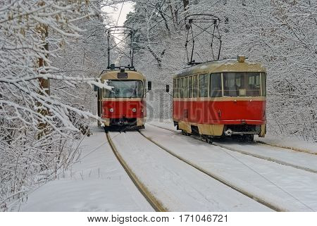 The meeting of two trams in a snowy winter woods as a symbol of the promise of the meeting with a loved one under all conditions and circumstances.
