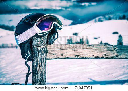Ski Helmet and Goggles. Ski Equipment Concept Photo.