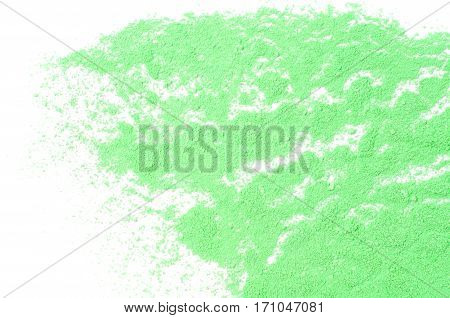 Sprinkled powder paint, green color background close up