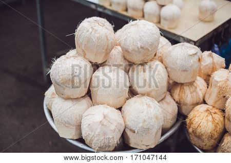 Coconuts In The Vietnamese Market, Typical Street Food Business In Asia