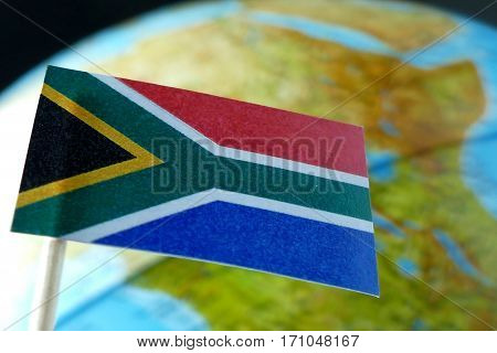 South Africa Flag With A Globe Map As A Background Macro