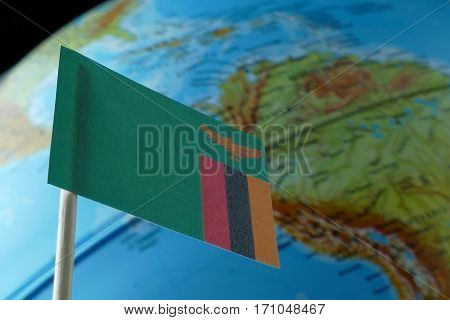 Zambia Flag With A Globe Map As A Background Macro