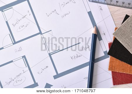 Decorator Workbench Background With Home Plan On Wooden Table Top