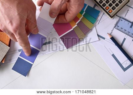 Decorator Showing A Color Tone On Work Table Top View