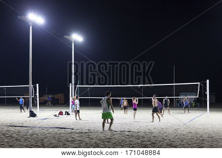 DUBAI UAE - DEC 5 2016: Beach Volleyball at night the Kite Beach in Jumeirah. Dubai United Arab Emirates