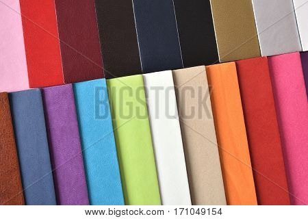 Materials textures and color cards for interior decoration. fabric and leather samples. Top view