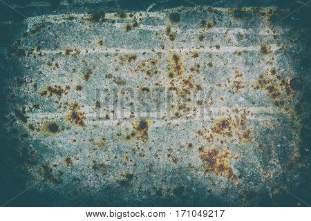 The surface of old steel sheet corrosion-damaged. Blue color. Stylized with a vignette effect.