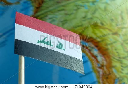 Iraq Flag With A Globe Map As A Background Macro