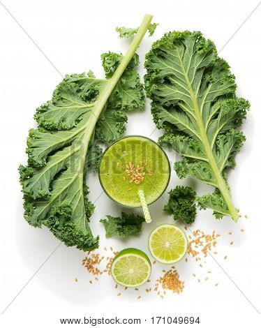 Top view of green smoothie from kale and seeds of flax isolated on white background.