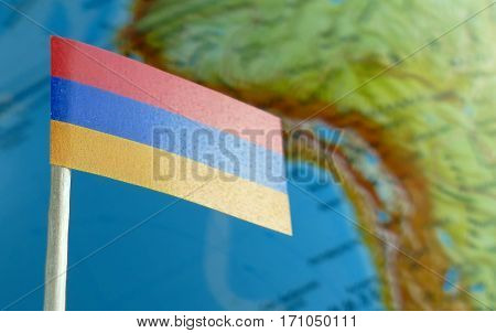 Armenia Flag With A Globe Map As A Background Macro