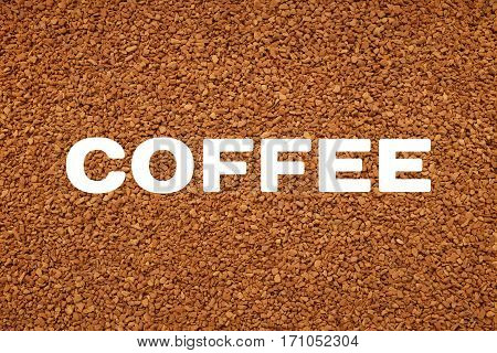 Coffee Text Over Background Of Freeze Dried Granules