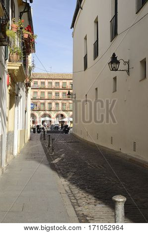 CORDOBA, SPAIN - DECEMBER 27, 2015: Street that leads into the Plaza of the Corredera in the old part of the city of Cordoba Andalusia Spain.