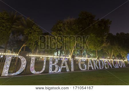 DUBAI UAE - DEC 6 2016: Dubai Garden Glow family theme park illuminated at night. United Arab Emirates Middle East