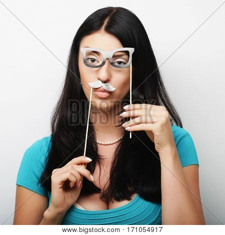 Young woman with  fake mustaches. Ready for party.