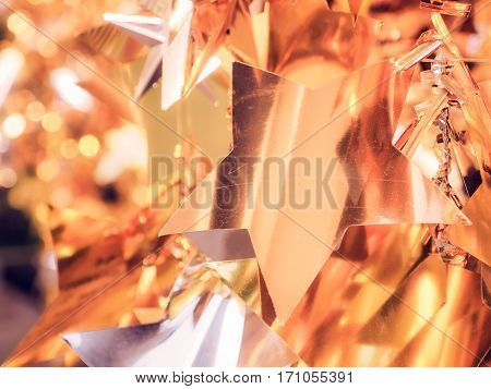 De focused gold star and white bokeh twinkling lights background, soft focus / De focused gold and yellow bokeh twinkling lights background