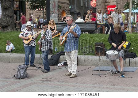 Kiev Ukraine - June 19 2016: Musical group consisting of adult men playing on the street Khreshchatyk at the weekend