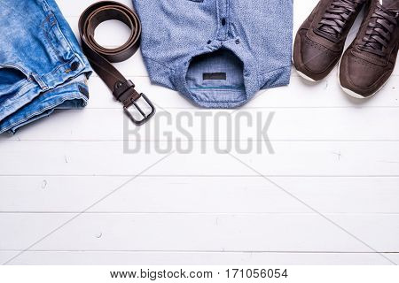 new male clothes on wooden background with text space, top view
