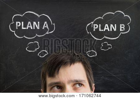 Young Man Is Making Decision And Selecting Strategy Between Plan
