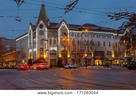 DNEPR UKRAINE - DECEMBER 25, 2016: Central part of the Dnepr city with hotel Ukraine and holiday illumination at evening time in Dnepr Ukraine, at December 25, 2016